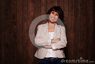 Smiling woman standing against the brown background