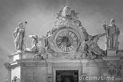 Statues and clock on the roof of the Vatican in Rome. Saint Peter
