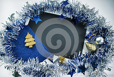 Christmas composition. Vintage Christmas greeting card. Blue sparkling ribbon wreath.