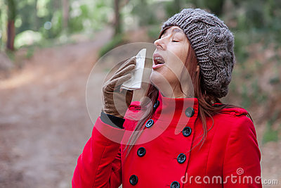 Young woman suffering from a cold, flu or allergies