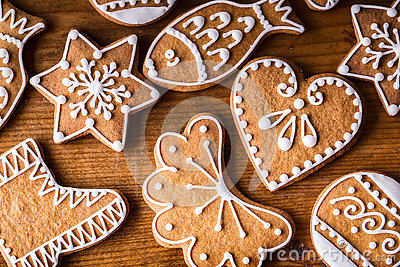 Christmas sweet cakes. Christmas homemade gingerbread cookies on wooden table
