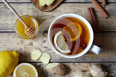 Antiviral Healthy drink useful tea with ginger, lemon and honey. . Hot winter beverage concept.