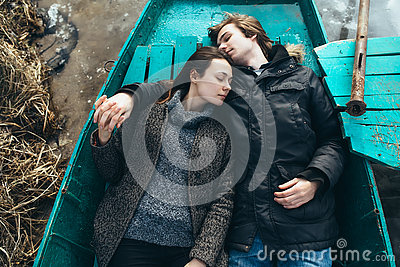 Man and woman lie in the boat