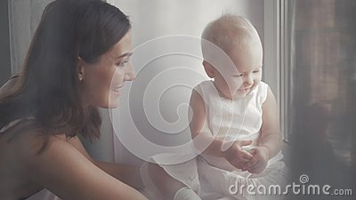 Happy family laughing faces, mother holding adorable child baby boy, smiling and hugging, close up border, beauty of