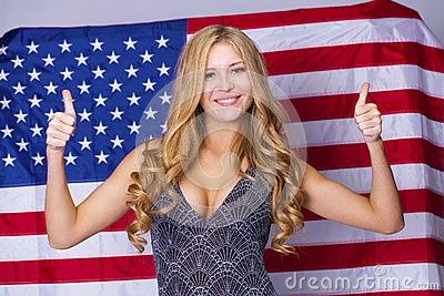 Happy young woman on a background of the American flag