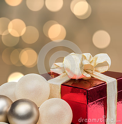 Christmas gift with defocused lights background.