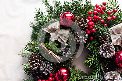 Detail of Christmas wreath with red baubles and berries