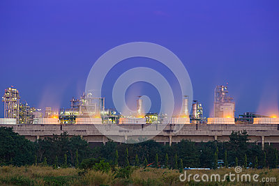 Cooling tower of oil refinery industrial plant at night, Thailan