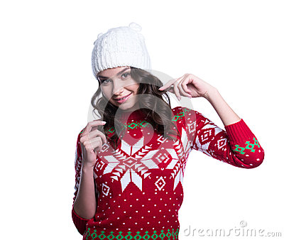 Smiling pretty young woman wearing colorful knitted sweater with christmas ornament and hat. Isolated on white background.