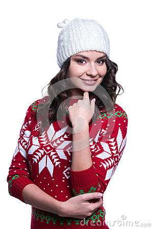 Smiling pretty sexy young woman wearing colorful knitted sweater with christmas ornament and hat. Isolated on white background.