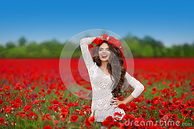 Hair. Beautiful happy smiling teen girl portrait with red flower