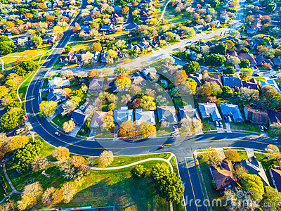 Real Estate Back of Community with Colorful Leaves turning colors for Fall Autumn Texas Hill Country Neighborhood Suburb Home Deve