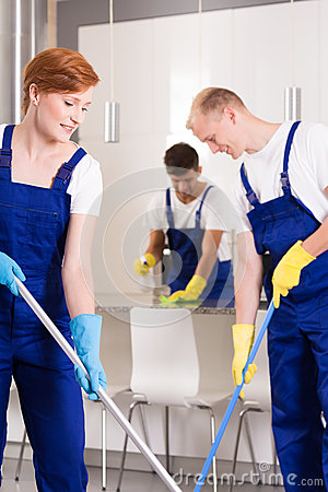 Cleaners mopping flor