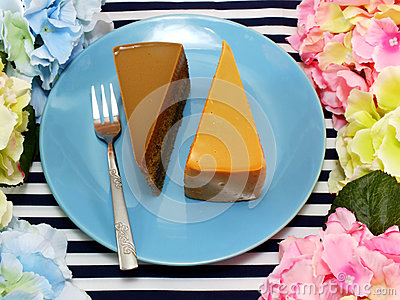 Cake homemade on dish with spring flower and space copy background
