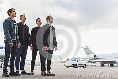 Guys waiting for airplane arrival