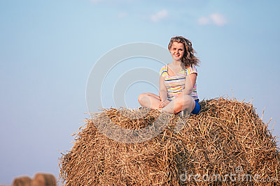 Beautiful Plus Size Young Woman In Shirt Sit Near Hay Bales In Summer