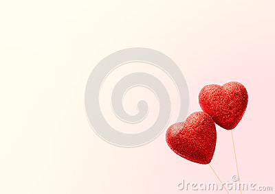Greeting card for Valentine`s Day , with two red hearts .