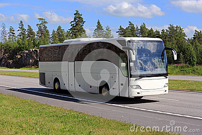 White Coach Bus Travel along Freeway at Summer