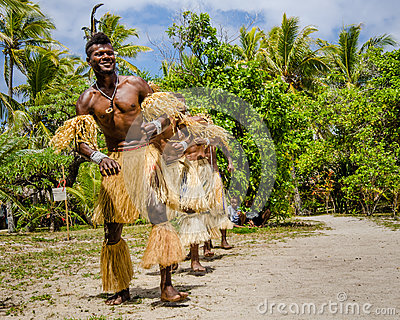 Native dancers entertain tourists visiting Mystery Island.