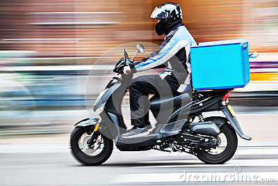 Scooter delivery service in motion blur
