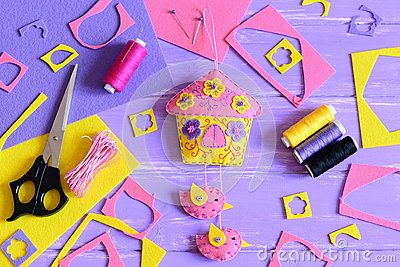 Easy wall decoration make of felt. Handcraft supplies on a wooden table. Spring or summer crafts idea for children and adults