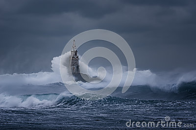 Cloudy day. Dramatic sky and huge waves at the Lighthouse, Ahtopol, Bulgaria