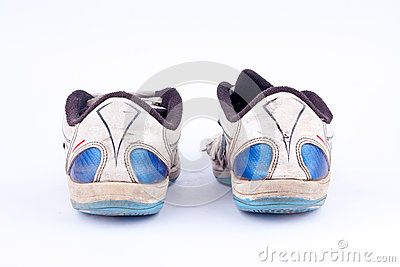 Old retro worn out futsal sports shoes  on white background    back view