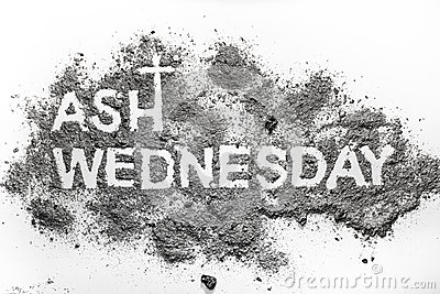 Ash wednesday word written in ash and christian cross symbol