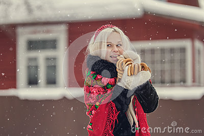 Portrait of a young caucasian woman in russian style on a strong frost in a winter snowy day. Russian model girl