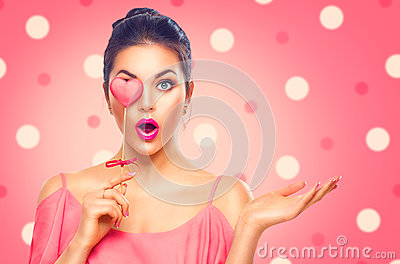 Valentine`s Day. Beauty model girl with Valentine heart shaped cookie