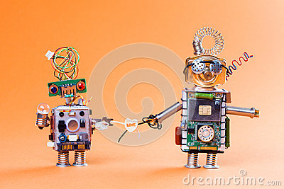 Robot love story concept. Funny circuit socket toys with lamp bulb and  heart symbol. Cute faces, blue red eyes  glasses