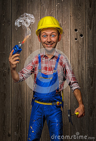 Funny Craftsman with Hammer, cordless screwdriver and helmet