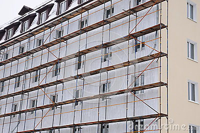 Detail renovation of house with scaffolding. Reconstruction of old building