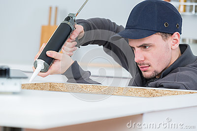 Putting adhesive on wood