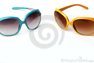 Blue and yellow sunglasses on a white background