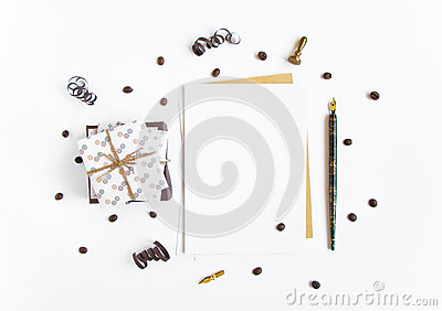 Rustic handmade gifts and a letter on white background decorated with serpentine and coffee beans. Top view, flat lay