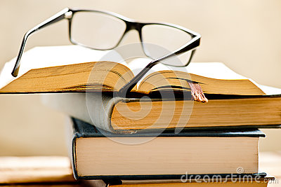 Open book with reading glasses