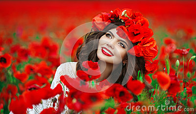 Beautiful happy smiling teen girl portrait with red flowers on h
