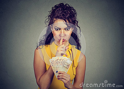Corrupt, secretive woman with euro money showing shhh sign