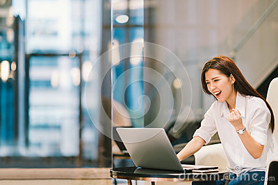 Beautiful Asian girl celebrate with laptop, success pose, education or technology or startup business concept, with copy space