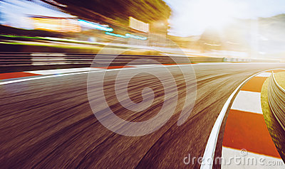 Motion blurred racetrack,sunset scene.