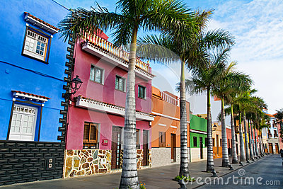 Tenerife. Colourful houses and palm trees on street in Puerto de