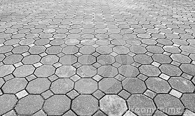 Perspective View of Monotone Grunge Gray Brick Stone on The Ground for Street Road. Sidewalk, Driveway, Pavers, Pavement in Vintag