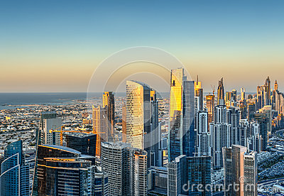 Beautiful modern city architecure at sunset. Aerial skyline of Dubai, UAE.
