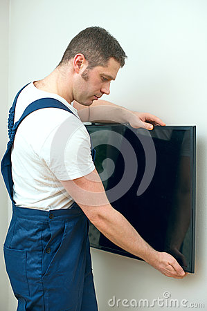 Man mounting TV.