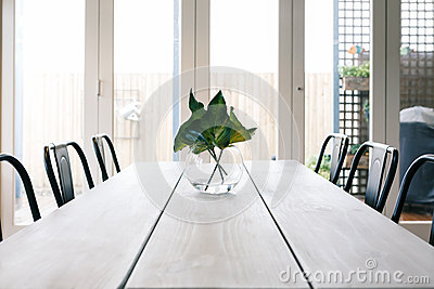 Simple background of a light bright contemporary dining room tab