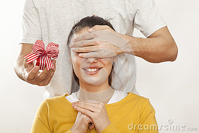 Man holding gift box and giving girlfriend