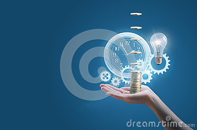 Business woman in the hand of a clock gears money and the lamp symbolizes the effective implementation.