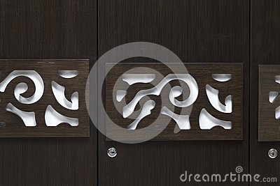 Beutiful contemporary modern looking design on a wardrobe door made of dark Brown coloured plywood