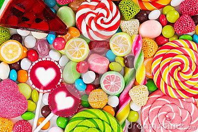 Colorful lollipops and different colored round candy.